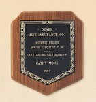 American Walnut Shield Plaque with a Black Brass Plate. Shield Plaques